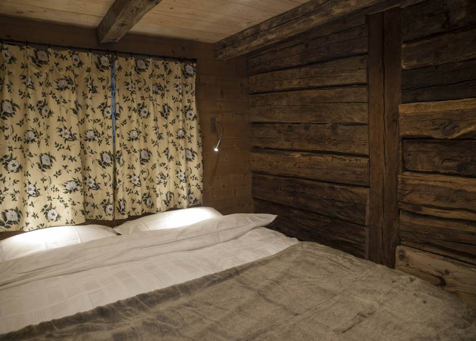 Old beams add character to the bedroom
