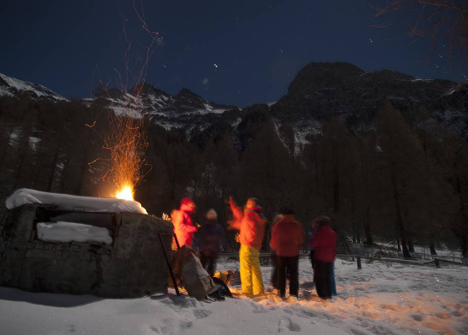 Toasting marshmallows by full moon, Plat de la Lee beyond Zinal